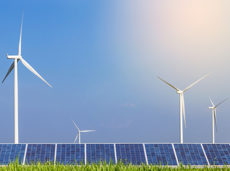 generating station: solar photovoltaics  panel and wind turbines generating electricity in solar power station Stock Photo