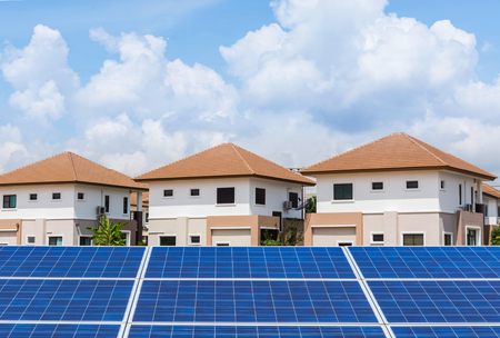 residential home: solar photovoltaics panels with residential new home     background
