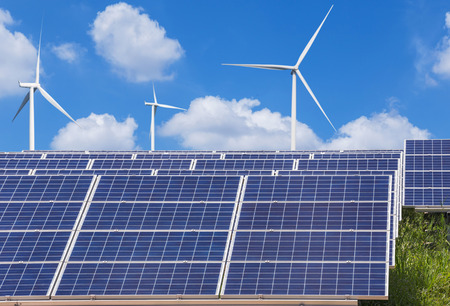 generating station: photovoltaics  solar panels and wind turbines generating electricity in solar power station alternative energy from nature Stock Photo