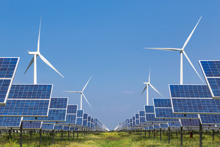 photovoltaics  solar panels and wind turbines generating electricity in solar power station renewable energy from natural