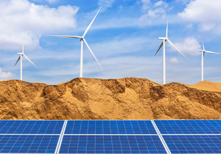 photovoltaics solar cells and wind turbines generating electricity in desert. Global warming concept