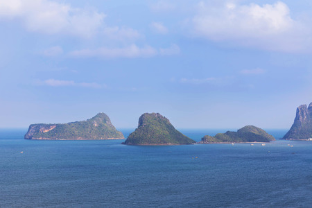 snorkelers: view of small tropical limestone island in Thailand.