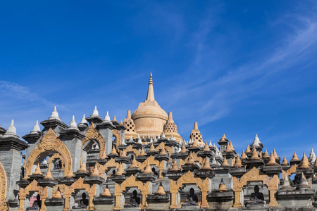 Sandstone pagoda in wat  Pa Kung temple at Roi Et of Thailand on blue sky
