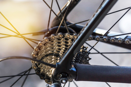 Close up mountain bike cassette on the rear wheel with chain selective focus. Stock Photo