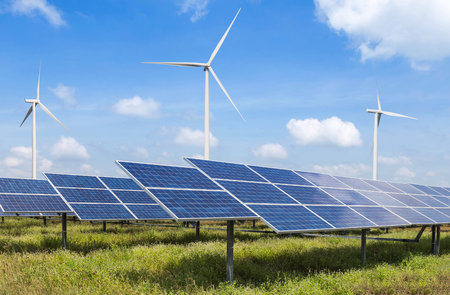 solar panels photovoltaics  and wind turbines generating electricity in  power station alternative energy from nature  Ecology concept.
