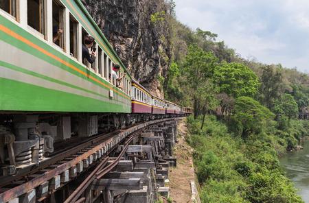 kanchanaburi: passenger thai train moving on death of railway world war II between tham krasae railway station river kwai kanchanaburi Thailand