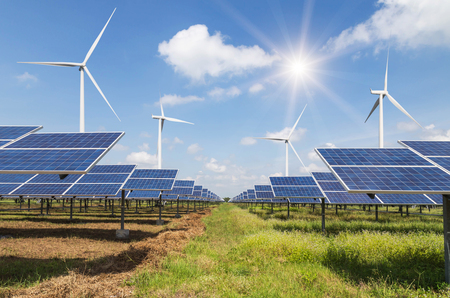solar cells and wind turbines generating electricity in  power station alternative renewable energy from nature  Ecology concept.