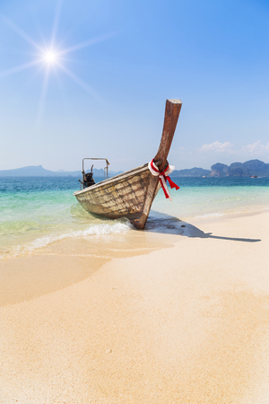Longtail boat mooring on the tropical beach in the andaman sea krabi Thailand Stock Photo