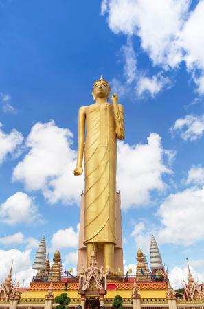 antiques: The public Buddha imagae statue tallest standing at wat Burapapiram temple Roiet, thailand blue sky background