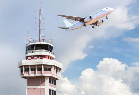 traffic controller: Air traffic control tower in international airport with passenger airplane jet taking off on blue sky  in the background