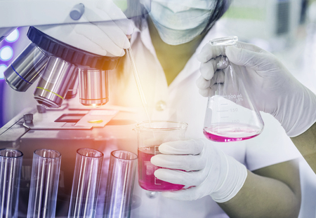 Double exposure  scientist woman research carrying chemistry liquid to test tube with hand scientist holding flask with microscope equipment for research experiments at science laboratory