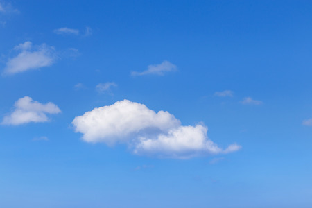 abstract white clouds on clear blue sky background in tropical climate
