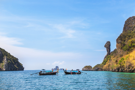 Longtail boats moored floating in andaman sea at Koh Kai or chicken rock island, Krabi, Thailand is popular for tourist snorkelling trip
