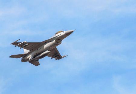 falcon fighter jet military aircraft flying with high speed on blue sky Stock Photo