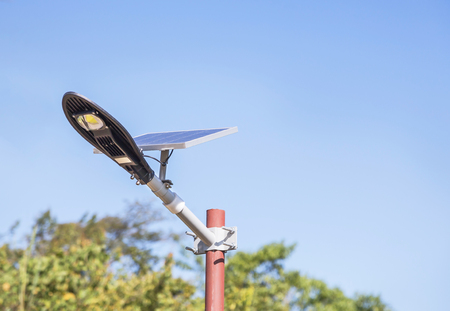 solar power street light in public park turn up skyward absorb the sunlight from the sun use light energy to generate electricity alternative renewable energy from the sun Stock Photo
