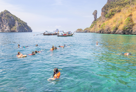 Tourists enjoy snorkeling with life jackets in andaman sea at phi phi islands, Thailand Editorial