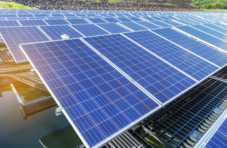 Close up rows array of polycrystalline silicon solar cells or photovoltaics in solar power plant turn up skyward absorb the sunlight from the sun alternative renewable energy