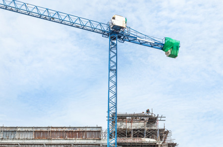 construction crane in construction site on blue sky