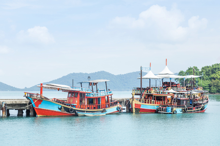 Colorful Thai wooden fishing boats floating moored in coast at Koh Chang island and Trad province, Thailand Reklamní fotografie