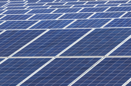 Close up rows array of polycrystalline silicon solar cells or photovoltaic cells in solar power plant turn up skyward absorb the sunlight from the sun