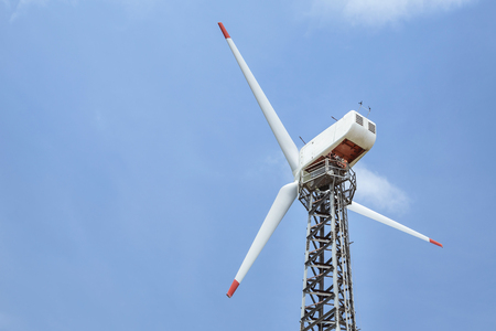white wind turbines generating electricity in wind power station alternative renewable energy from nature under blue sky