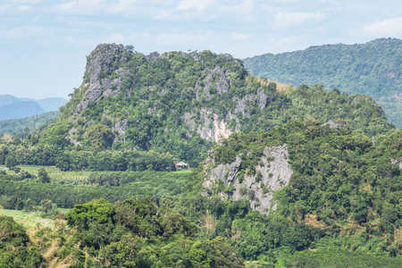 High angle landscape view over rainforest  limestone mountains from Phu Pa Por view point at Loei province ,Thailand .