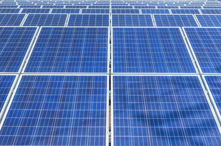 Close up rows array of Solar panels or solar cells or photovoltaics in solar power station is power production technology renewable green clean energy energy efficiency from the sun Reklamní fotografie