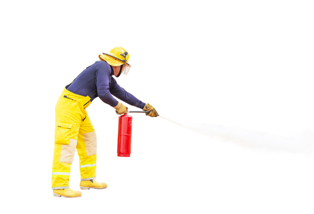 Fireman in yellow fire fighter uniform using fire extinguisher from hose extinguished to fighting with fire flame isolated on white background