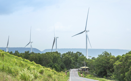 White wind turbines generating electricity in wind power station at Lam Takhong reservoir dam, Nakhon Ratchasima, Thailand