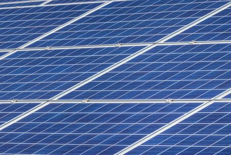 Close up polycrystalline silicon solar cells or photovoltaic cells in solar power plant station turn up skyward absorb the sunlight from the sun