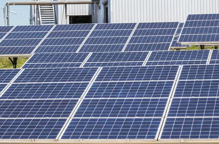 polycrystalline silicon solar cells or photovoltaic cells in solar power plant station turn up skyward absorb the sunlight from the sun