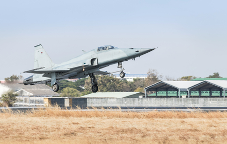 Fighter jet military aircraft flying with high speed take off  from runway Redakční