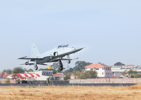 Fighter jet military aircraft flying with high speed take off  from runway with steam from exhaust