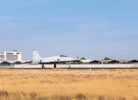 Fighter jet military aircraft preparing take off with high speed from runway