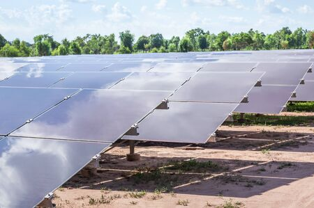 Close up array of  thin film solar cells or amorphous silicon solar cells or photovoltaics in solar power plant turn up skyward absorb the sunlight from the sun