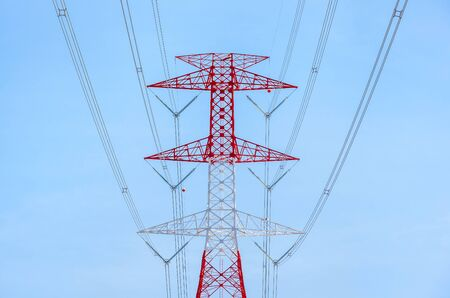 High voltage electrical pylon in electric power plants power substation on blue sky