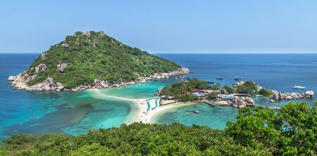 Aerial high landscape view over beach of Koh Nang Yuan Island under blue sky in summer day Koh Nang Yuan Island is most popular famous tourist attractions in the gulf of Thailand, Surat Thani, Thailand