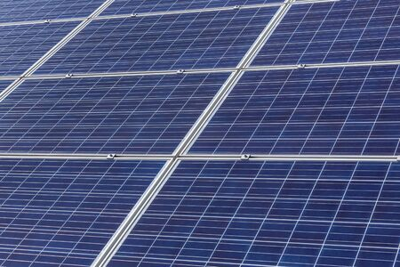 Close up rows array of polycrystalline silicon solar cells or photovoltaic cells in solar power plant station turn up skyward absorb the sunlight from the sun