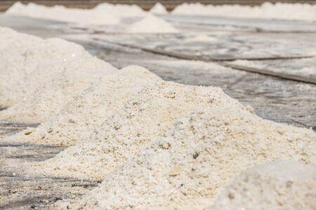 Close up piles of raw white sea salt in the salt farm samut songkhram province, Thailand on sunny day