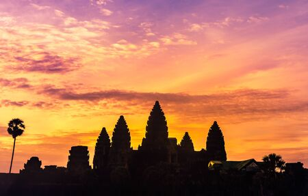 Silhouette angkor wat ancient temple reflection on the water in sunrise time at  Siem reap, Cambodia
