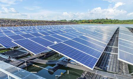 Row of solar cells floating on the water in solar power station