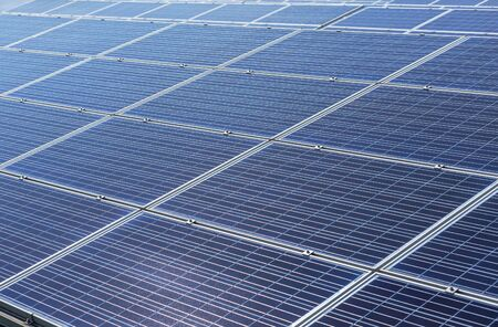 Close up rows array of solar cells or photovoltaics in solar power station alternative clean renewable energy efficiency 免版税图像