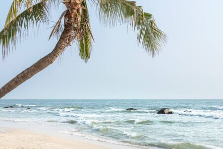 Soft wave in turquoise sea rolling splash in to tropical sandy beach at Hua Hin beach Thailand
