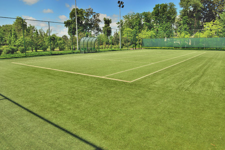 lawn tennis: Tennis court in the landscaped park