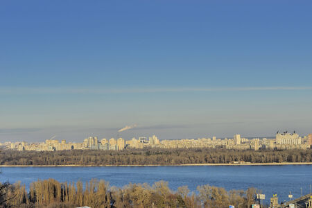 especially: View of the river Dnieper. This view of the river Dnepr, left its shores. houses and buildings  is especially beautiful in the early evening. Stock Photo