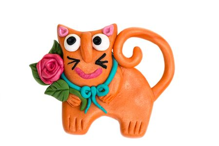 kitty cat: Brooch in the form of a cat with a rose made of polymer clay on a white background Stock Photo