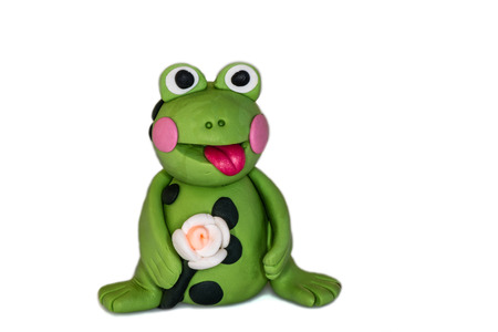 polymer: Frog figurine made of polymer clay on a white background.