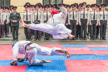 canal parade: KYIV, UKRAINE - May 26, 2017: Ceremony on the occasion of the end of the academic year in the Kiev military lyceum of Ivan Bohun. Martial arts.