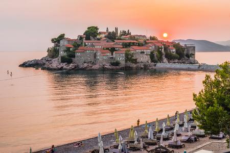 stephen: Beautiful view of the island-resort. Stephen (Sveti Stefan) on the Budva Riviera, Budva, Montenegro at sunset.
