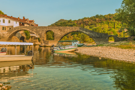 The old arched stone bridge of Crnojevica river on Montenegro. Editorial